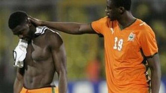 Kolo Toure (kiri) & Yaya Toure