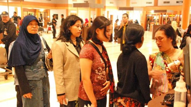 Pekerja migran saat tiba di Terminal 4 Bandara Soekarno-Hatta