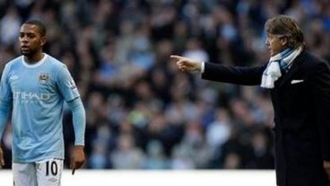 Roberto Mancini (kanan) dan Robinho