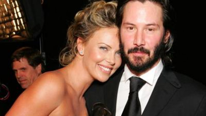Keanu Reeves & Charlize Theron