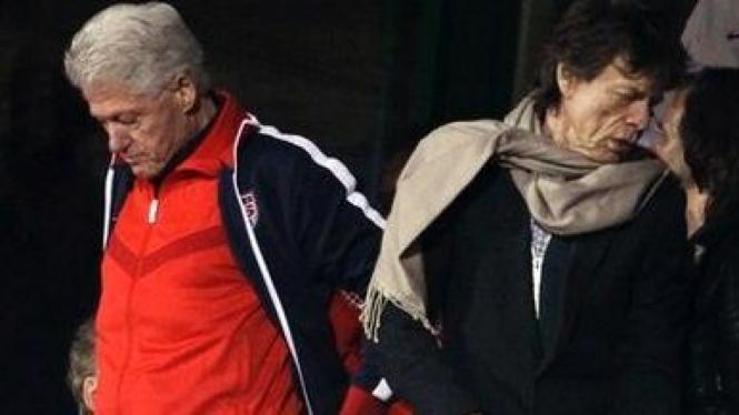 Bill Clinton (kiri) dan Mick Jagger