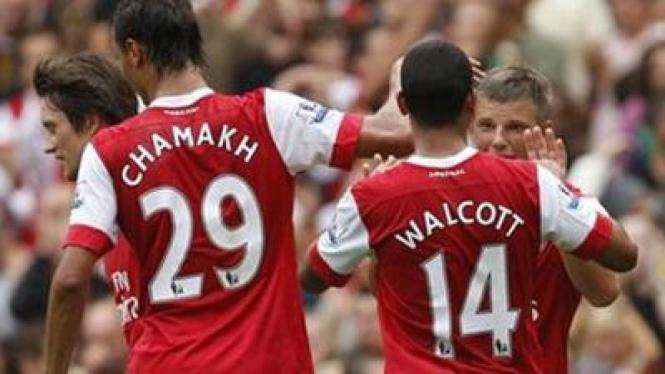 Pemain Arsenal merayakan kemenangan