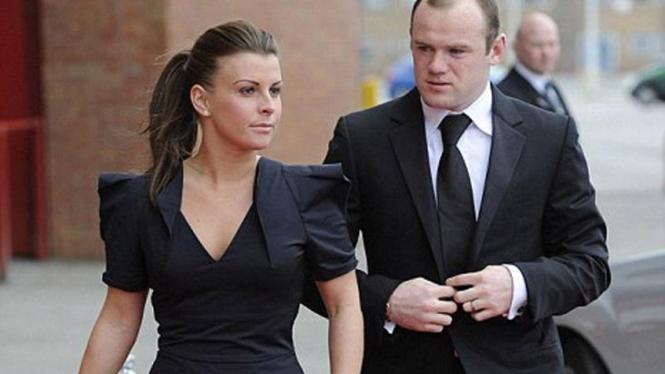 Wayne Rooney bersama istrinya Coleen