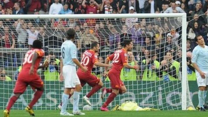 Marco Boriello usai merayakan golnya ke gawang Lazio
