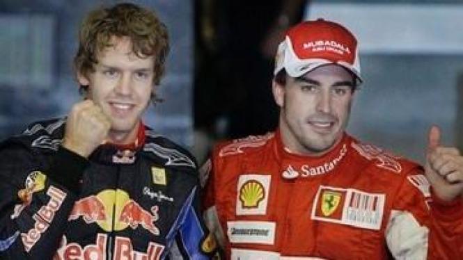 Sebastian Vettel (kiri) dan Fernando Alonso