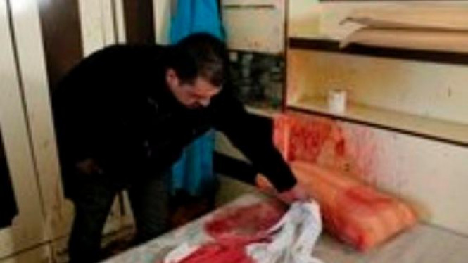 Bercak darah di tempat tidur Omar Kawasmeh