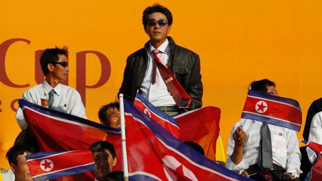 Suporter kesebelasan Korut di ajang Piala Asia 2011.