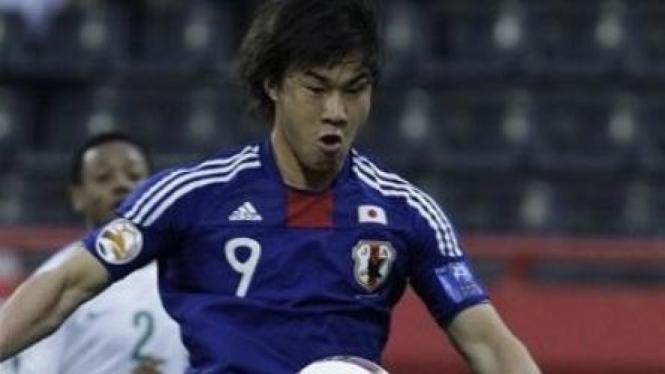 Shinji Okazaki (9) saat menghadapi Arab Saudi