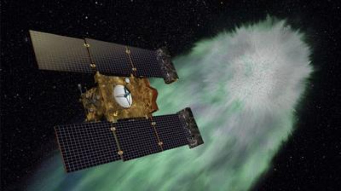 Komet Tempel 1 dan satelit Stardust-NExT milik NASA