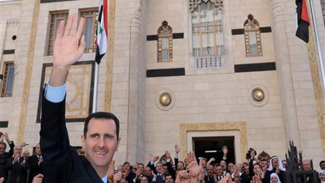 Presiden Bashar Assad disambut rakyat Suriah di Damaskus, Maret 2011