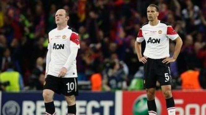 Rio Ferdinand (kanan) dan Wayne Rooney