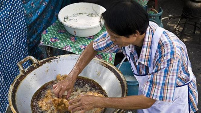 Trichan, koki yang menggoreng dengan tangan