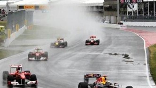 Sebastian Vettel (depan) di GP Kanada