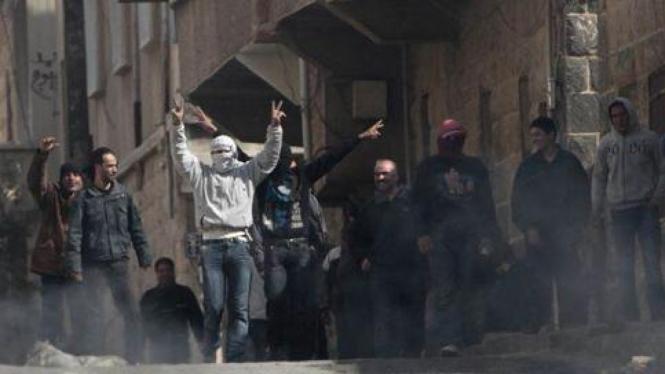 Demonstran anti rezim Suriah di kota Daraa.