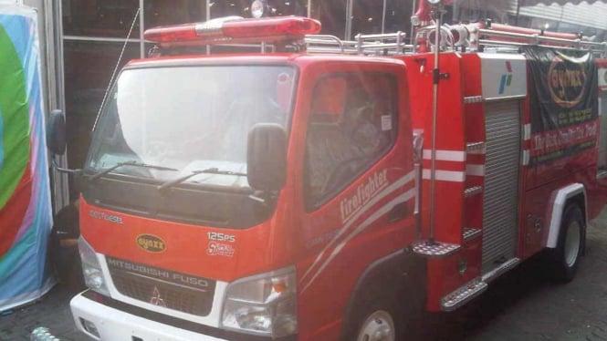 Ilustrasi mobil pemadam kebakaran.