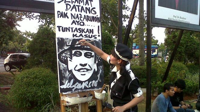 Lukisan selamat datang Nazaruddin di Bandara Halim Perdana Kusumah