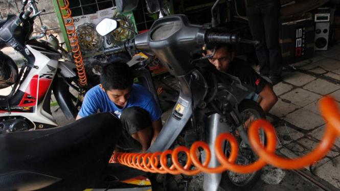 Bengkel sepeda motor. Foto ilustrasi