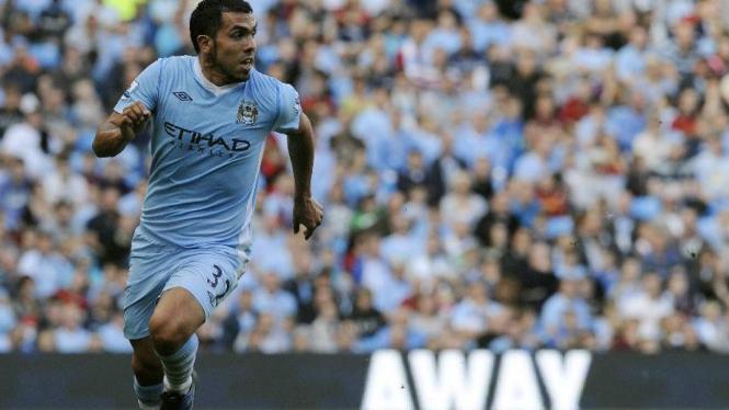 Carlos Tevez (Manchester City) saat melawan Wigan