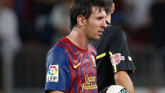 Striker Barcelona, Lionel Messi, saat melawan Valencia