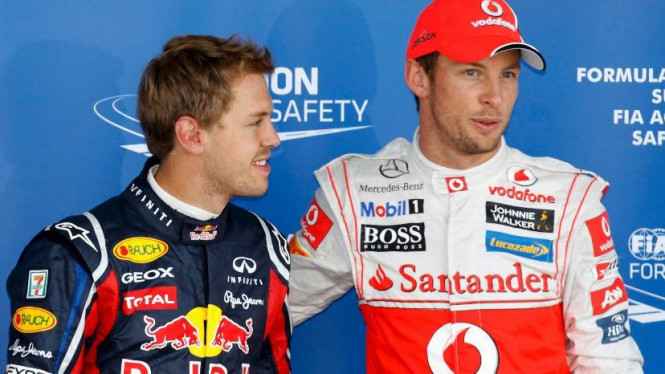 Jenson Button (kanan) dan Sebastian Vettel di GP Jepang