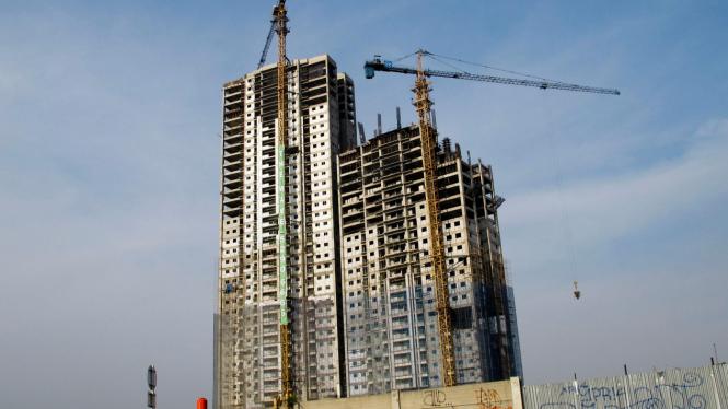 Ilustrasi pembangunan gedung bertingkat.