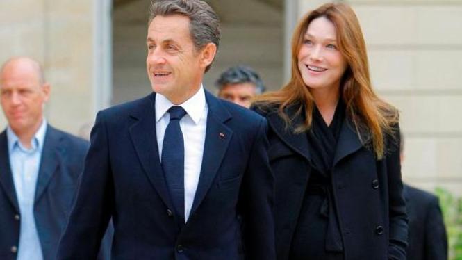 Mantan Presiden Prancis Nicolas Sarkozy dan istrinya Carla Bruni.