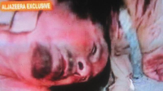 Foto mayat Muammar Khadafi yang ditayangkan Al Jazeera