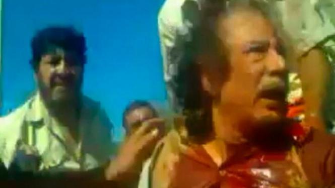 Moammar Khadafi saat ditangkap tentara NTC
