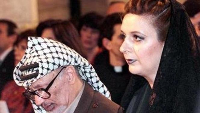 Yasser Arafat bersama istri, Suha.