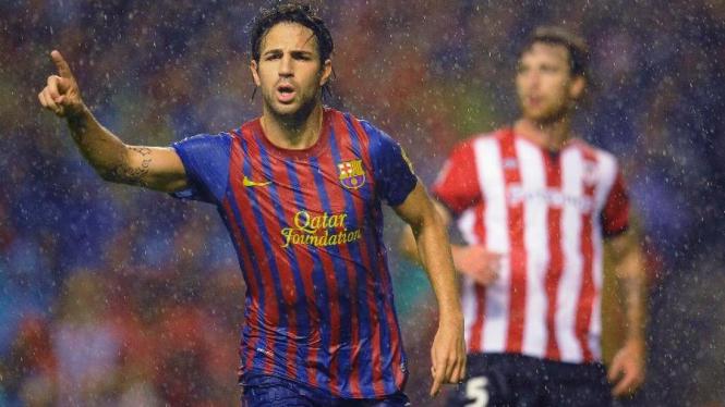 Cesc Fabregas merayakan gol ke gawang Athletic Bilbao