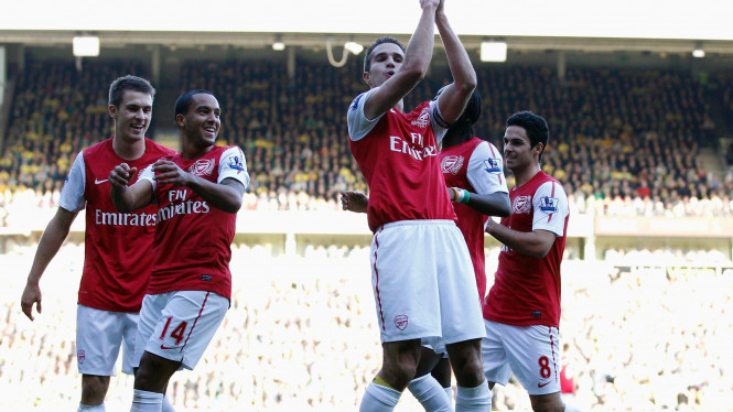 Pemain Arsenal merayakan gol ke jala Norwich City