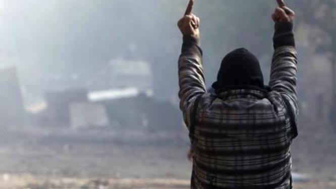 Salah satu demonstran dalam bentrokan di Kairo, Mesir