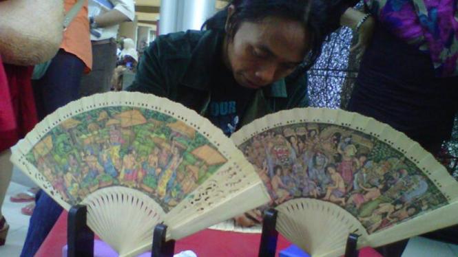 Mangku, pelukis kipas di EpiWalk