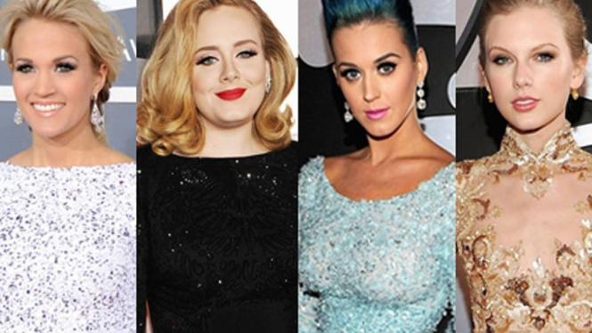 melenggang di karpet merah Grammy Awards dengan gaun berpotongan leher tinggi