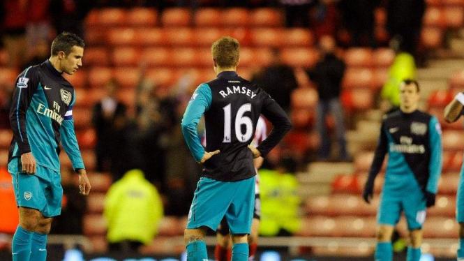 Robin van Persie (kiri) dan Aaron Ramsey saat Arsenal dikalahkan Sunderland