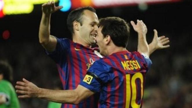 Andres Iniesta dan Lionel Messi