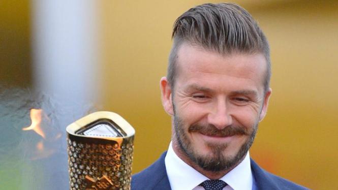 Beckham Bawa Obor Olimpiade ke London