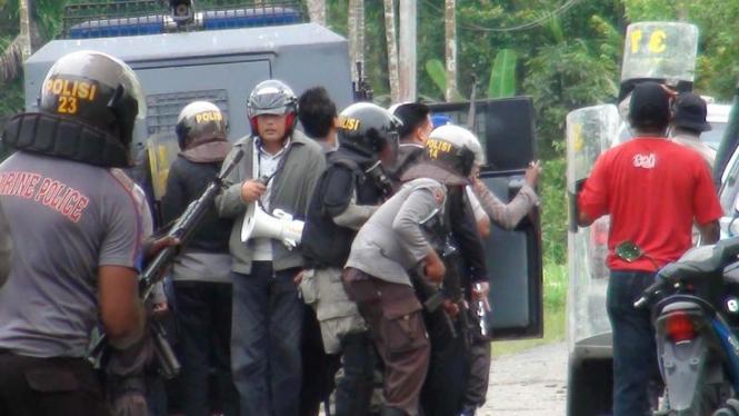 Bentrokan massa di Kwamki Lama, Timika, Papua