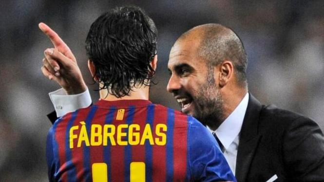 Pemain Barcelona, Cesc Fabregas dan Pep Guardiola.