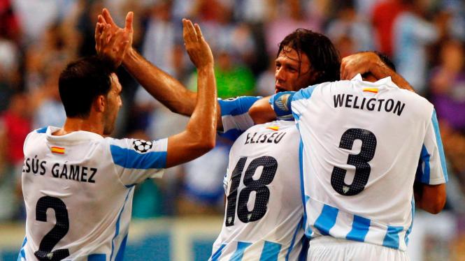 Pemain Malaga merayakan gol Pereira Eliseu