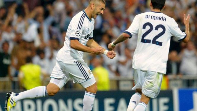 Striker Real Madrid, Karim Benzema (kiri), dan Angel Di Maria