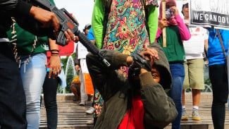 Ilustrasi Aksi Aktivis Perempuan Mengecam Kekerasan