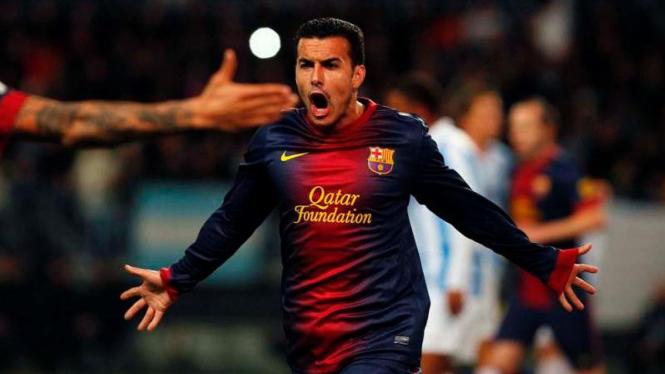 Pedro usai mencetak gol ke gawang Malaga