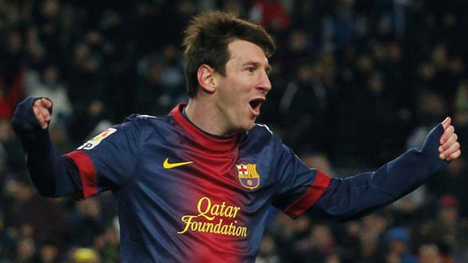 Lionel Messi usai mencetak gol Barcelona ke gawang Sevilla