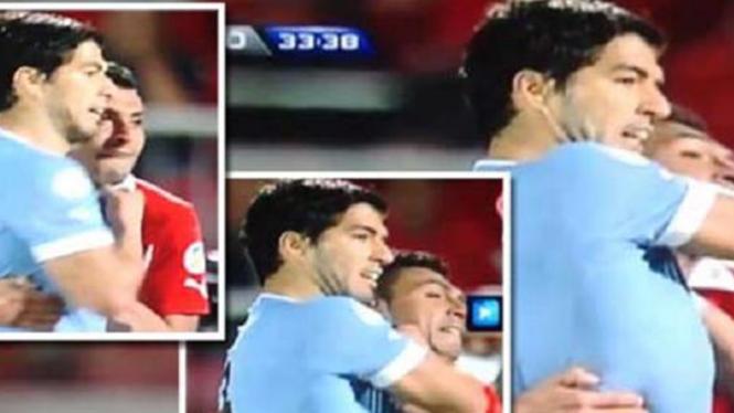 Luis Suarez tertangkap kamera memukul bek timnas Chile