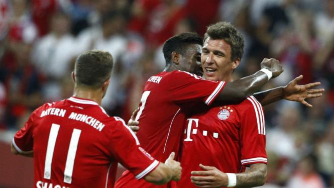 Para pemain Bayern Munich rayakan gol kemenangan
