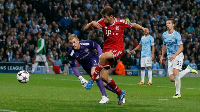 Thomas Mueller mencetak gol saat Manchester City vs Bayern Munich
