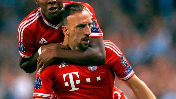 Pemain Bayern Munich, Franck Ribery, merayakan golnya