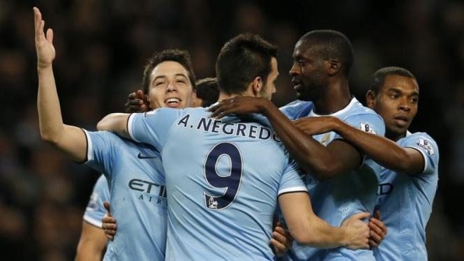 Pemain Manchester City merayakan gol