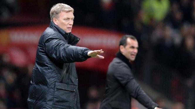Pelatih MU, David Moyes, saat menghadapi Everton